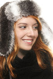 Smiling young redhead woman in winter dress lookin Royalty Free Stock Images