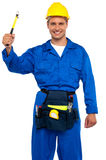 Smiling young repairman holding hammer Stock Images