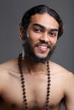 Smiling Young sadhu looking Stock Image