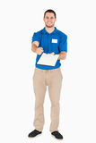 Smiling young sales assistant asking for signature Royalty Free Stock Photography