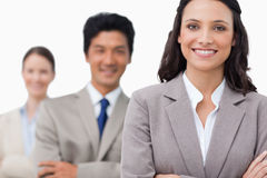 Smiling young salesteam with arms folded Royalty Free Stock Photos