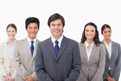 Smiling young salesteam standing Royalty Free Stock Photos