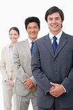 Smiling young salesteam standing in line Stock Images