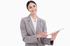 Smiling young saleswoman with her tablet computer Royalty Free Stock Photos