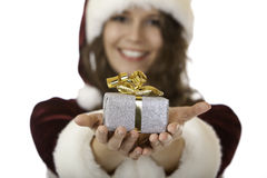 Smiling young santa claus woman has Christmas gift Royalty Free Stock Images