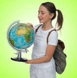 Smiling young schoolgirl with a globe Royalty Free Stock Photo