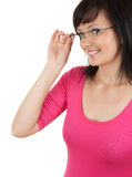 Smiling young secretary correcting glasses Royalty Free Stock Photos