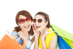 Smiling young sisters holding shopping bags Royalty Free Stock Image