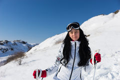 Smiling Young Ski Woman at the Mountain Resort Stock Images