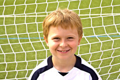 Smiling young soccer player Royalty Free Stock Photos
