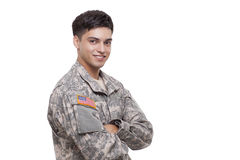 Smiling young soldier with arms crossed Royalty Free Stock Photo
