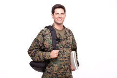Smiling young soldier with documents and backpack Royalty Free Stock Photo