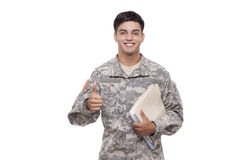 Smiling young soldier with documents gesturing thumbs up Stock Photos