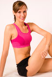 Smiling young sportswoman stock image