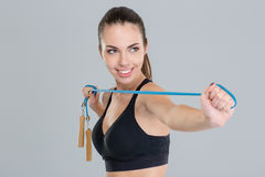 Smiling young sportswoman in black top with jumping rope Royalty Free Stock Photo