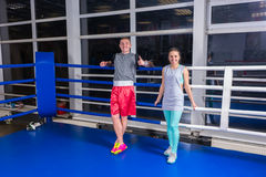Smiling young sporty couple in sportswear resting after workout Royalty Free Stock Images