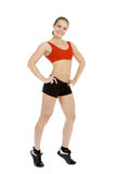 Smiling young sporty muscular woman Stock Images
