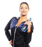 Smiling young sporty woman with water Stock Photos