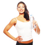 Smiling young sporty woman with water Stock Photo