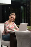 Smiling Young Student In Cafe Using Laptop Stock Images