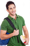 Smiling Young student carrying bag and books Stock Photos