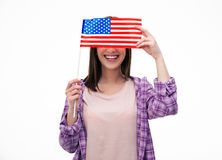 Smiling young student covering her eyes with flag Royalty Free Stock Images
