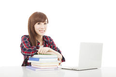 Smiling young student girl with book and laptop isolated on whit Stock Image