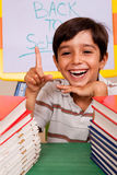 Smiling young student pointing up Stock Photos