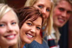 Smiling young student showing individuality Stock Photos