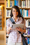 A smiling young student using a tablet computer Stock Photos