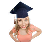 Smiling young student woman in mortarboard Stock Photography