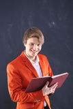 Smiling young teacher holding scoreboards Stock Images