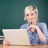 Smiling Young Teacher Using Laptop At School Stock Photos