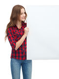 Smiling young teenage girl with white blank board Royalty Free Stock Photo