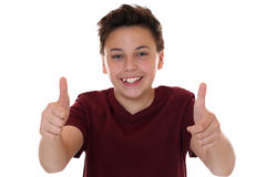 Smiling young teenager boy showing thumbs up Royalty Free Stock Photos
