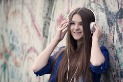 Smiling young teenager listening to music Royalty Free Stock Image