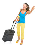 Smiling tourist woman with bag catching taxi Royalty Free Stock Photo