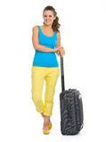 Smiling young tourist woman with wheel bag Royalty Free Stock Images