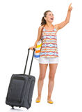 Smiling young tourist woman with wheel bag Royalty Free Stock Image