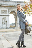 Smiling young trendy woman in Paris, France looking aside Stock Photos