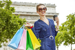 Smiling young trendy woman with shopping bags in Paris, France Royalty Free Stock Photos