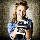 Smiling Young Vintage Girl Taking Polaroid Photo. Young Retro Woman Holding A Instant Polaroid Camera While Displaying Her Creative Self Portrait Photo Royalty Free Stock Image