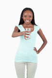 Smiling young water offering a glass of water Stock Photos