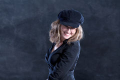 Smiling young woman. Young woman smiling, french style, with beret and glasses, looking coquettishly Royalty Free Stock Images