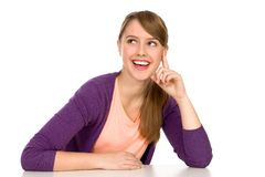 Smiling Young Woman. Pretty young woman leaning on a table Stock Images