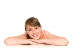 Smiling Young Woman. Pretty young woman leaning on a table Stock Image