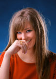 Smiling young woman. On a blue background stock photo