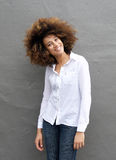 Smiling young woman with afro hairstyle Stock Image