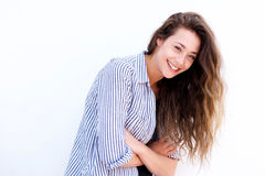 Smiling young woman against white background. Portrait of smiling young woman against white background Royalty Free Stock Photos