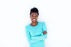 Smiling young woman against white wall. Portrait of smiling young woman against white wall Royalty Free Stock Photos